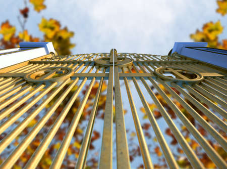 hereafter: A concept image of the golden gates to heaven shut on an autumn leave and blue sky background Stock Photo