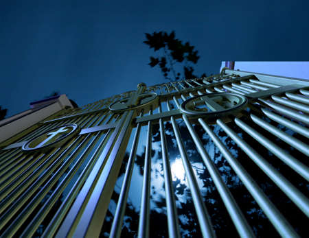 gateway: The  concept image showing religious cemetery gates at night on a moonlit eerie background with trees Stock Photo