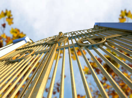 kingdom of heaven: A concept image of the golden gates to heaven shut on an autumn leave and blue sky background Stock Photo