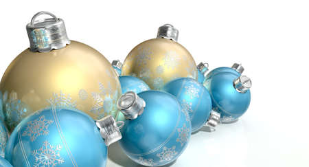 A collection of a mix of small and large matte gold and blue christmas baubles decorated with fine ornate snowflake patterns on an isolated white background photo