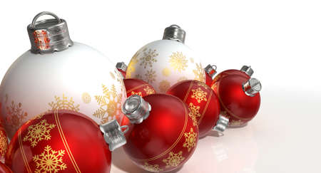 A collection of a mix of small and large matte red and white christmas baubles decorated with fine ornate snowflake patterns on an isolated white background photo