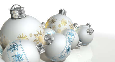 burnished: A collection of a mix of small and large matte white christmas baubles decorated with fine ornate snowflake patterns in gold and blue on an isolated white background Stock Photo