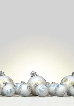 A collection of a mix of small and large matte white christmas baubles decorated with fine ornate snowflake patterns in gold and blue on an isolated white background photo