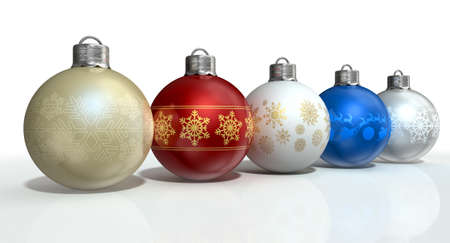 A line of five assorted colored christmas baubles decorated with fine ornate snowflake patterns on an isolated white background photo