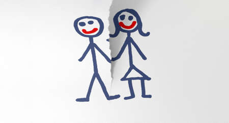 heartbreak issues: A white piece of paper tearing in two through a child like sketch of a man and woman holding hands