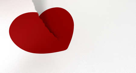 parting: A white piece of paper tearing in two through a drawn red heart