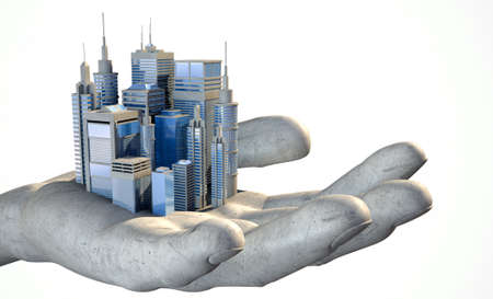 A small modern looking city nestled in the palm of an open hard hand on an isolated white background photo