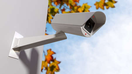 ccd camera: A white wireless surveillance camera with illuminated lights mounted on a wall in the daytime with copy space Stock Photo
