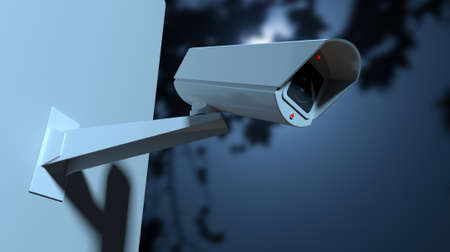 A white wireless surveillance camera with illuminated lights mounted on a wall in the night-time with copy space photo