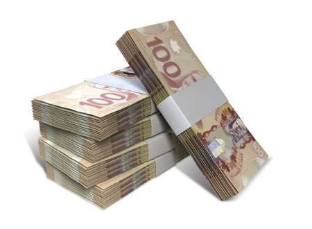 canadian currency: A stack of bundled Canadian Dollar banknotes on an isolated background Stock Photo