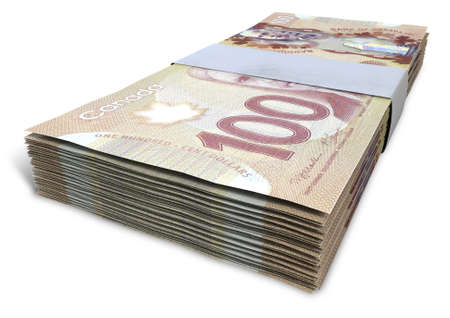 A stack of bundled Canadian Dollar banknotes on an isolated background Stock Photo