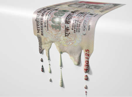 A concept image showing a regular Indian Rupee banknote that is half melted and liquified dripping on an isolated studdio background