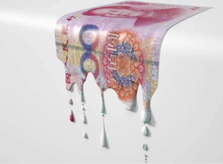 A concept image showing a regular Chinese Yuan banknote that is half melted and liquified dripping on an isolated studdio background Stock Photo