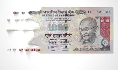 indian currency: A concept image showing a regular Indian Rupee banknote that is half melted and liquified dripping on an isolated studdio background