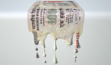 liquified: A concept image showing a regular Indian Rupee banknote that is half melted and liquified dripping on an isolated studdio background