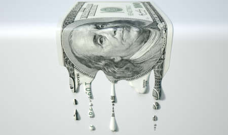 liquified: A concept image showing a regular US Dollar banknote that is half melted and liquified dripping on an isolated studdio background