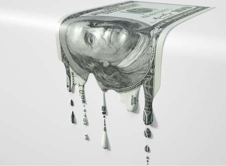 vanish: A concept image showing a regular US Dollar banknote that is half melted and liquified dripping on an isolated studdio background