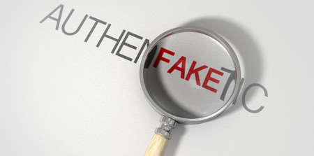 A concept image of a magnifying glass with a wooden handle on a textured white surface showing the word authentic but magnifying the word fake resembling counterfeitting Imagens
