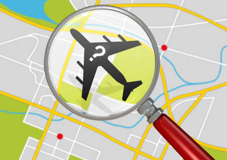 A silhouette of a plane with a question mark flying above a gps type land map  magnified by a magnifying glass depicting searching for a missing airplane photo