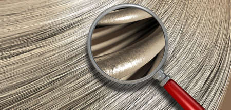 A closeup view of a bunch of shiny straight blonde hair in a wavy curved style with a section microscopically magnified to show individual strands of hair Stockfoto