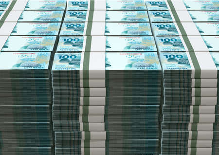 wads: A pile of wads of brazilian real banknotes on an isolated background Stock Photo