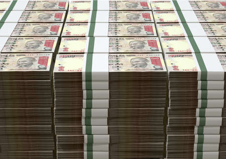rupee: A pile of rstacked wads of indian rupee banknotes on an isolated background