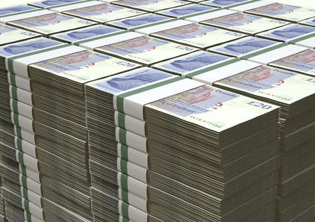 wads: A stack of bundled British Pound Sterling banknotes on an isolated background