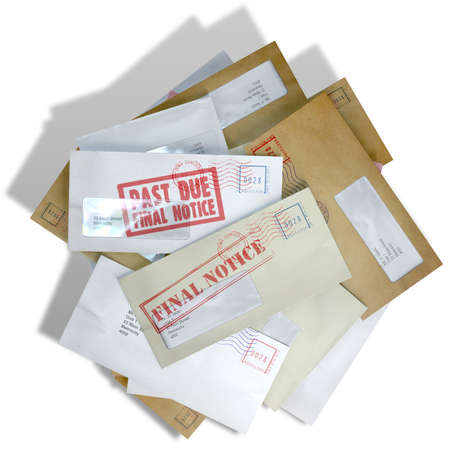 A scattered stack of regular envelopes with delivery stamps and a clear window and the top pink one saying payment due symbolizing bills and debt on an isolated white background photo