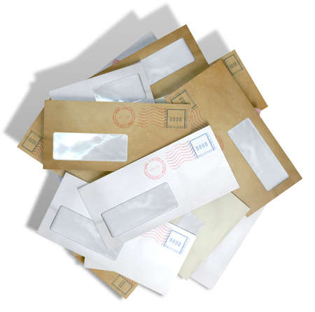 unpaid: A scattered stack of regular envelopes with delivery stamps and a clear window on an isolated white background