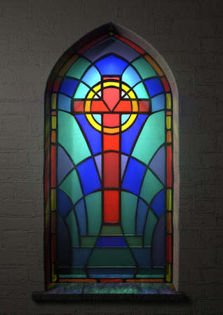 A colorful patterned stain glass window with the shape of a crucifix designed into it highlighted with a beam of light shining through it on an isolated wall space