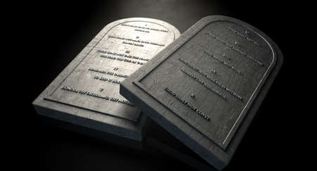 stone tablet: Two representative stone tablets with the ten commandments inscribed on them on an isolated dark ethereal background