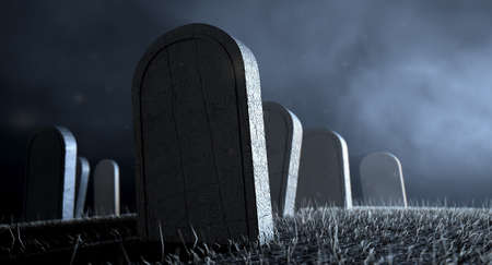 Tombstones in a graveyard at night lit by an ethereal eerie light photo