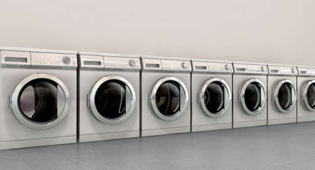 A perspective view of a row of empty regular brushed metal washing machines in an empty room with a shiny tiled floor and a grey wall