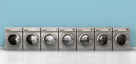 A front view of a row of empty regular brushed metal washing machines in an empty room with a shiny tiled floor and a baby blue wall Stockfoto