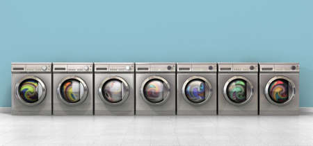A front view of a row of regular brushed metal washing machines filled with clothing in an empty room with a shiny tiled floor and a baby blue wall photo