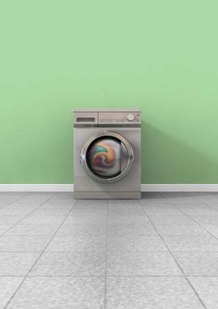 A front view of a regular brushed metal washing machine filled with clothing in an empty room with a shiny tiled floor and a green wall