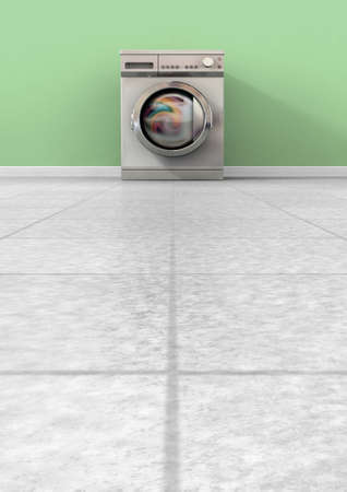 bygone: A front view of a regular brushed metal washing machine filled with clothing in an empty room with a shiny tiled floor and a green wall
