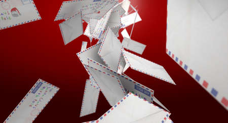 A falling collection of airmail envelopes  addressed to santa claus on an isolated red background photo