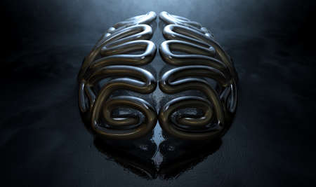 metal casting: A bronze casting depicting a stylized brain in contrasting light on an eerie lit isolated dark background Stock Photo
