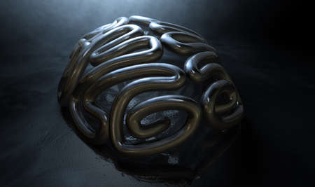 contrasting: A bronze casting depicting a stylized brain in contrasting light on an eerie lit isolated dark background Stock Photo
