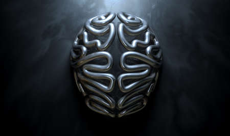 divided: A bronze casting depicting a stylized brain in contrasting light on an eerie lit isolated dark background Stock Photo