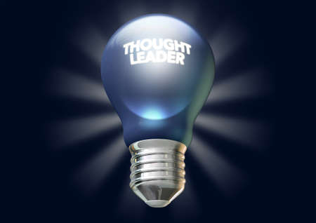 regarded: A regular blue light bulb with the phrase thought leadership illuminated on it on an isolated dark blue background with stylized irradiating rays