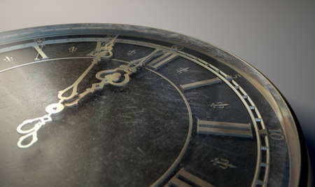 embellished: An extreme closeup of a section of a round antique watch with roman numerals and ornate metal hands approaching midnight on an isolated dark background