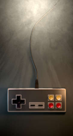 A regular vintage rectangular gaming controller with red and yellow buttons on an isolated dark spotlit studio background photo