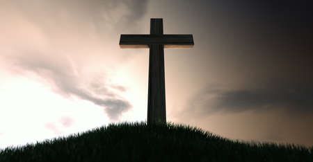 wooden cross: A dramatic silhouette of a wooden crucifix on top of a grassy hill on a warm sunrise morning  Stock Photo