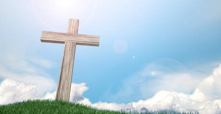passion of the christ: A wooden crucifix on top of a green grassy hill on a warm sunny blue sky  background with white fluffy clouds