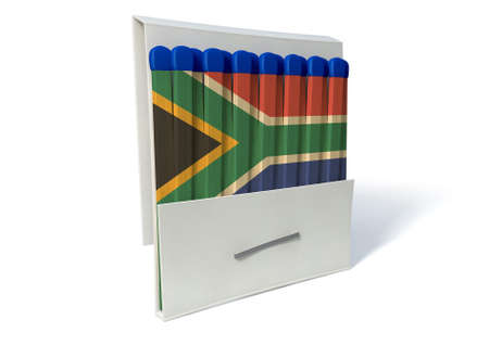 An closeup of an open book of matches made with wood decorated in the south african national flag and brown tips on an isolated background photo