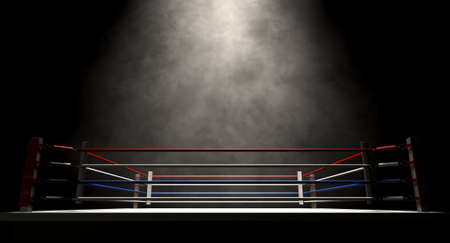boxing match: A regular boxing ring surrounded by ropes spotlit in the missle on an isolated dark background Stock Photo