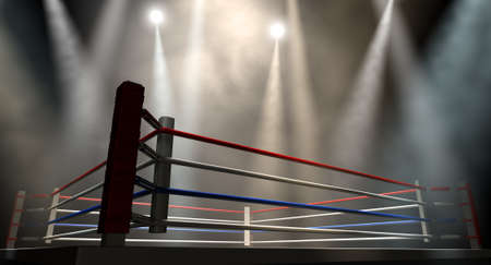 spotlit: A regular boxing ring surrounded by ropes spotlit by various lights on an isolated dark background