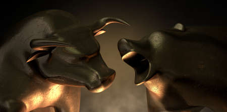 market trends: An abstract closeup of two gold cast statuettes depicting a stylized bull and a bear in dramatic contrasting light representing a financial market trends on an isolated dark background